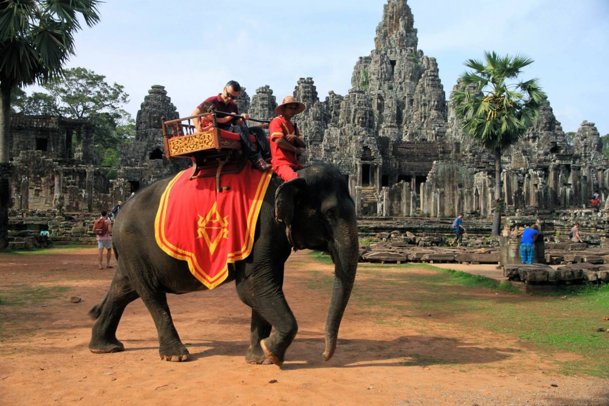 Tourists riding an elephant in Angkor Wat, Cambodia
