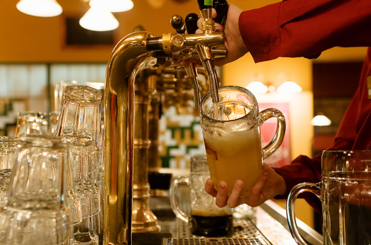 Man is pouring beer into the glass