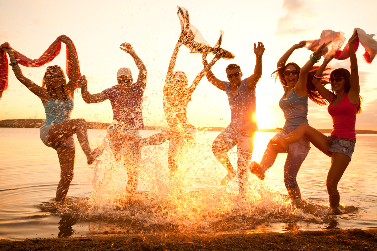 A group of young people are having fun at the beach